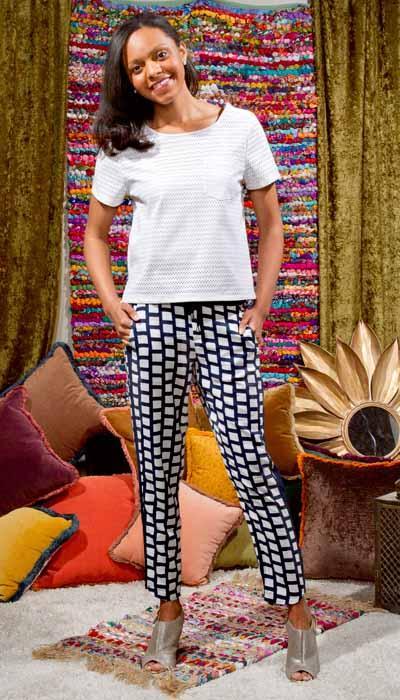 On Maya: BB Dakota white vegan leather perforated top; Splendid printed pant; Seychelles clog heel