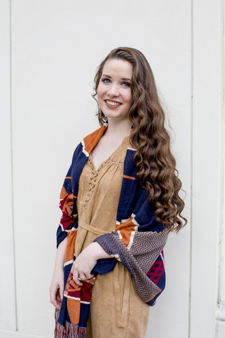 Mikayla is wearing a Camel suede dress with a Kerisma wrap from Sachi.